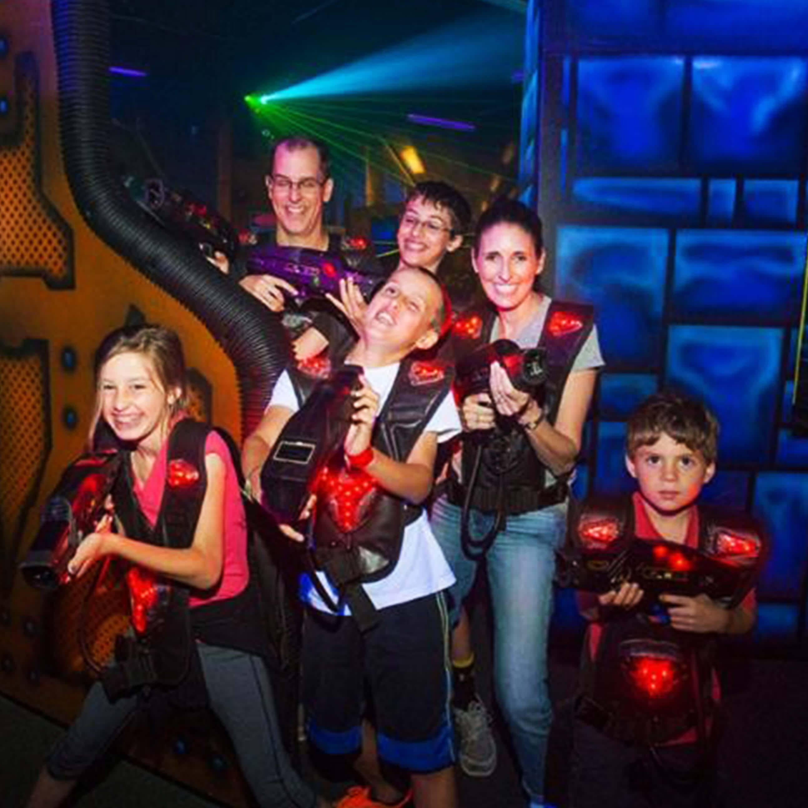 Family playing laser tag at Legacy 925
